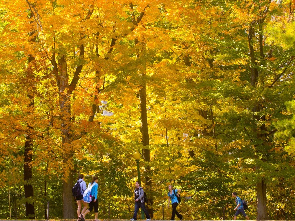 Students walk during a break from classes between Ballantine Hall and Goodbody Hall.