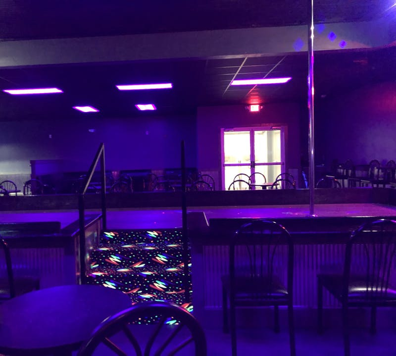 The stage at Night Moves strip club sits Jan. 23. The club reopened Thursday after the city bought its old building as part of the plan to build Switchyard Park.