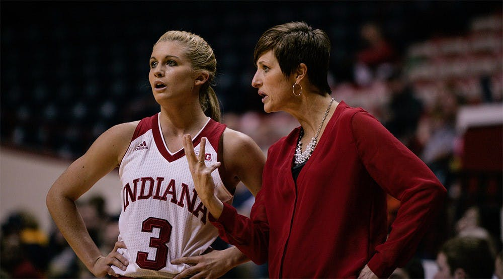 Sophomore guard Tyra Buss and head coach Teri Moren talk strategy during a stopage in play against Gerogia Tech Dec. 2. IU beat Georgia Tech 69-60.