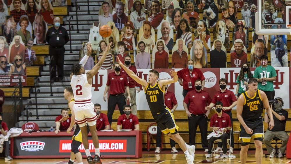 Sophomore guard Armaan Franklin shoots the game-winning shot over Iowa defender Joe Weiskamp on Sunday at Simon Skjodt Assembly Hall. IU defeated No. 8 Iowa 67-65 on Franklin's 2-point shot with less than 2 seconds left in the game.