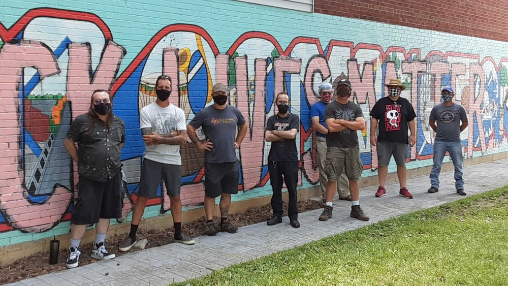 Members of the former Bloomington branch of the Anti-Racist Action network pose for a photo in front of the mural in Peoples Park. The group came from a variety of backgrounds and locations, including Seattle and Roanoke, Virginia.