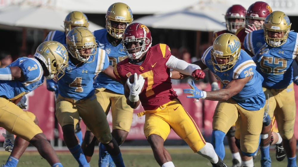 USC Trojans then-junior running back Stephen Carr runs past Bruins defenders Nov 23, 2019 in Los Angeles. Carr is transferring to IU ahead of his fifth collegiate season.