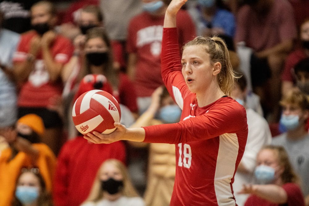 <p>Junior Kaley Rammelsberg prepares to serve during the Indiana volleyball's Cream and Crimson Scrimmage on Aug. 21, 2021, at Wilkinson Hall. Indiana beat Rutgers 3-1 Friday and lost to Maryland 3-0 Saturday.</p>