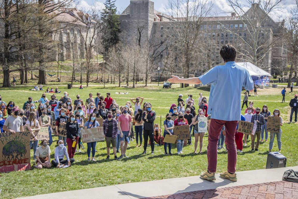 """<p>Steven Rigg, founder of Students for a New Green World, speaks at the """"Keep the Promise"""" protest  on March 24 in Dunn Meadow. The demonstration included speakers, a musical performance and a march around the IMU.</p>"""
