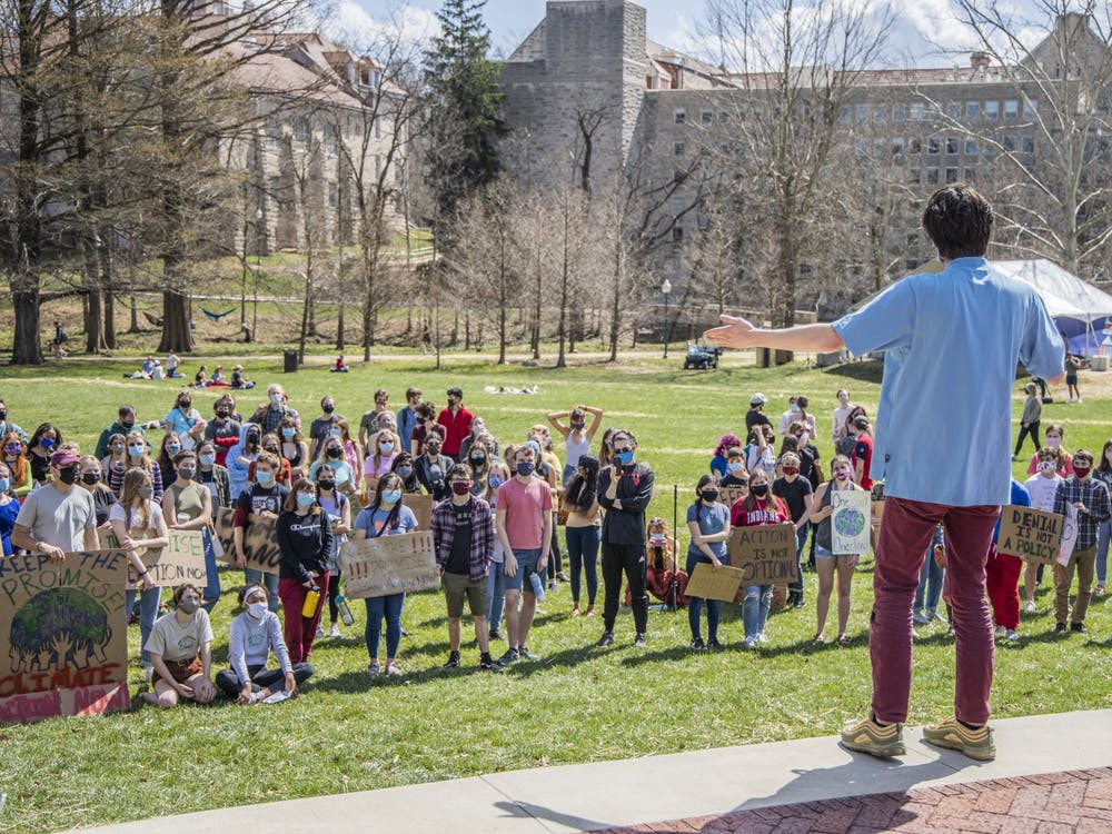 """Steven Rigg, founder of Students for a New Green World, speaks at the """"Keep the Promise"""" protest  on March 24 in Dunn Meadow. The demonstration included speakers, a musical performance and a march around the IMU."""