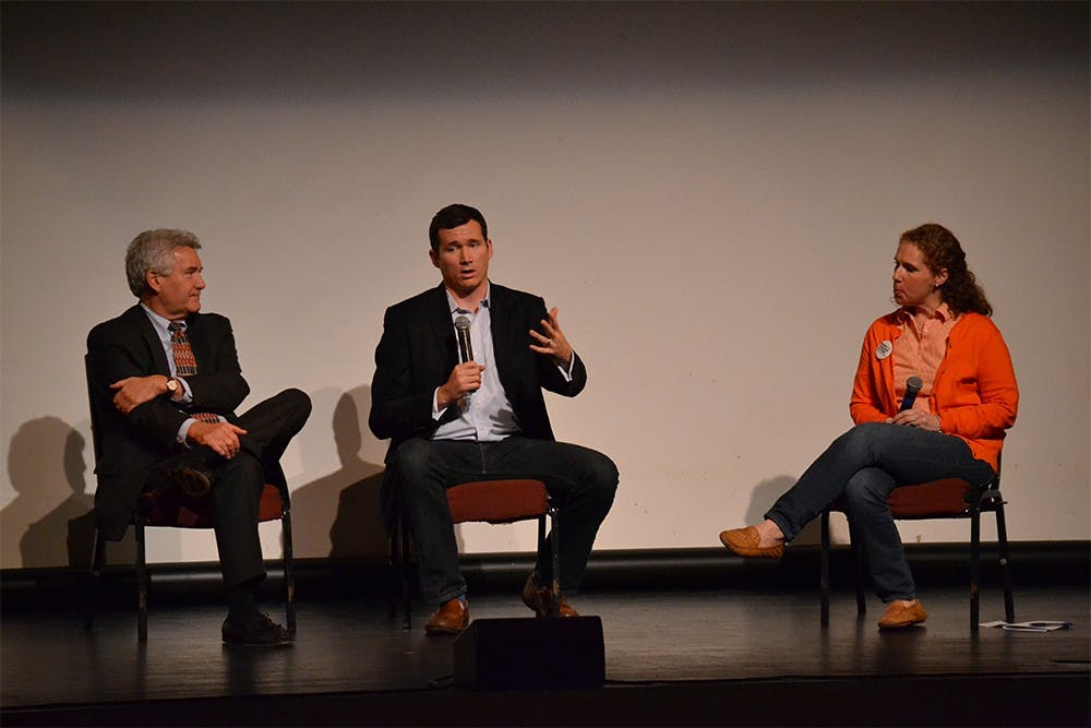 Senior Policy Advocate at Everytown for Gun Safety Colin Goddard (middle) joins in on a panel discussion with Director of IU's Civic Leaders Living-Learning Center Paul Helmke and Indiana Chapter Leader of Moms Demand Action for Gun Sense in America Stephanie Mannon Grabow Sunday afternoon at the Buskirk-Chumley Theater.