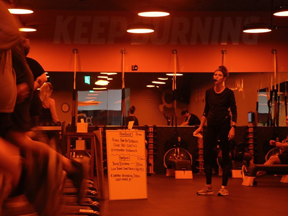 At the end of their run, Head Coach Jean Sherfick encourages the treadmill station to finish strong. This was the second time they had completed the 12-minute run for distance challenge, and soon they would be able to compare data with their previous run.