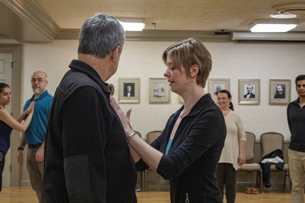 <p>Tango facilitators Amaury de Siqueira and Elise Boruvka demonstrate form March 8 in the Georgian Room of the Indiana Memorial Union. Boruvka was a member in the Argentine tango class  in 2008 as an undergrad at IU and is now a co-facilitator. </p>