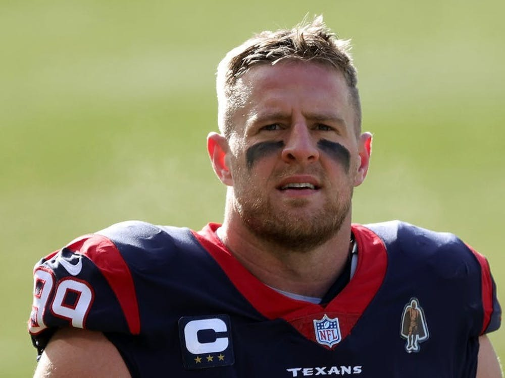 Former Houston Texans defensive end J.J. Watt walks to the locker room before a game against the Chicago Bears on Dec. 13 at Soldier Field in Chicago, Illinois. Watt announced Monday that he will sign with the Arizona Cardinals for next season.