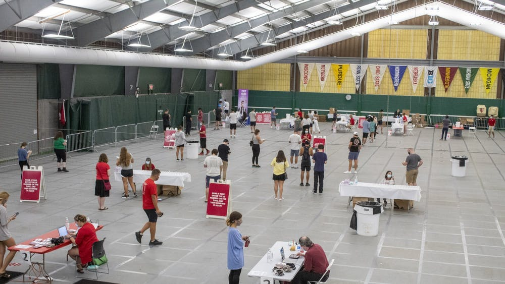 Students line up for their off-campus housing COVID-19 tests Aug. 18 in the IU Tennis Center. All students living in off-campus housing are required to schedule a COVID-19 test by Aug. 20.