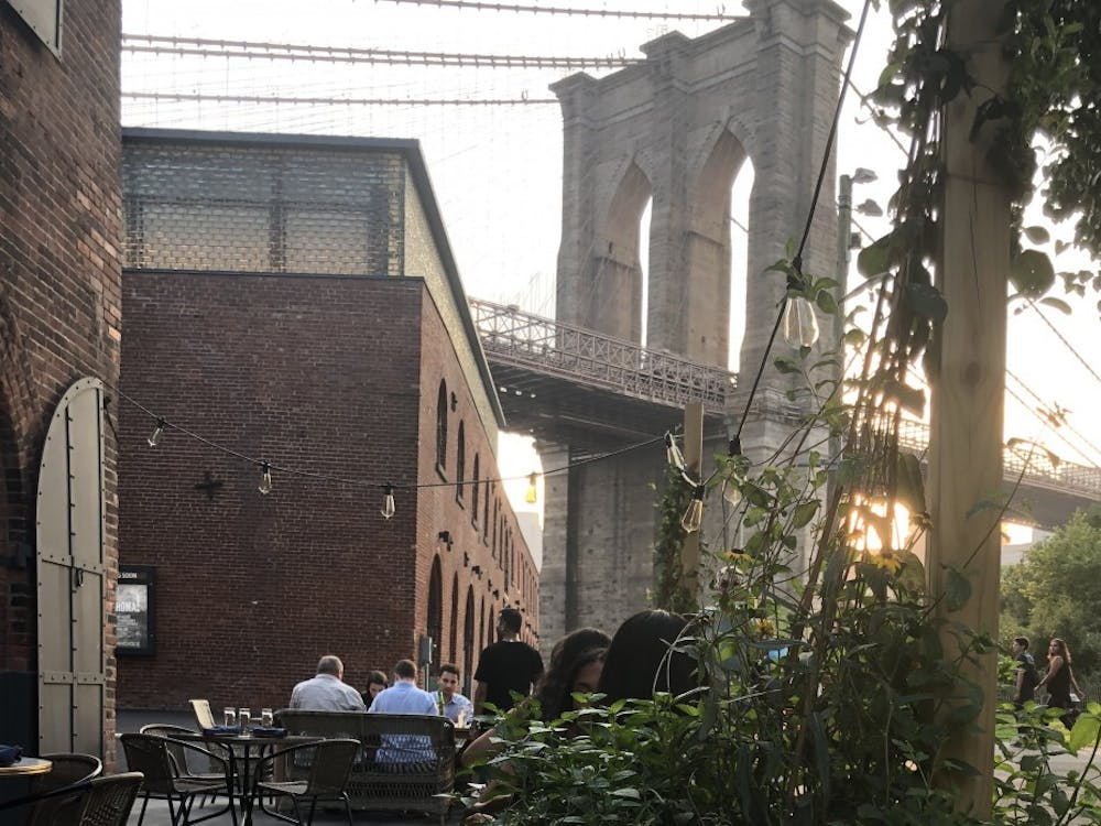 A view of the Brooklyn Bridge from SUGARCANE Raw Bar Grill's outdoor patio.