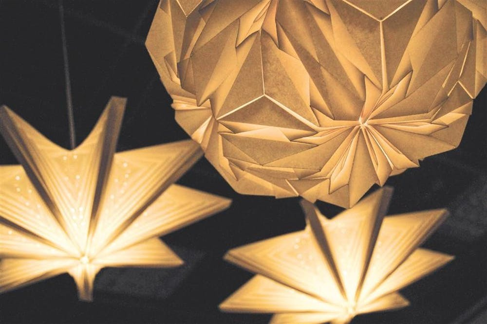 """Paper light sculptures handmade by Jiangmei Wu, feautured this month at the John Waldron Arts Center with her exhibition """"Folding into Light."""""""