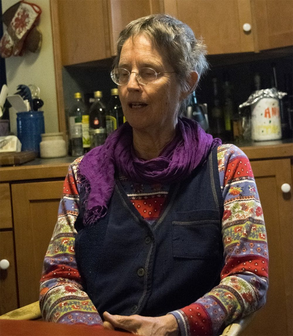 Ann Kreilkamp talks about astrology at her apartment Tuesday evening. Ann Kreilkamp studied philosophy at Boston College. She taught at an New College of California in California for one year until she was fired. After leaving the New College of California she began studying astrology and pursues it as a hobby. She is the outreach coordinator for the Green Acres Permaculture Village.