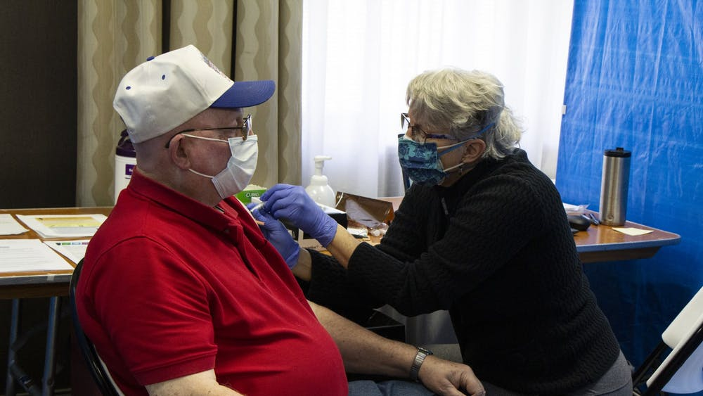 Nurse Cathy Green gives Raymond Lamar his second dose of the Moderna COVID-19 vaccine Feb. 24 at the Monroe Convention Center. Indiana has lowered the eligibility age for vaccinations to 50, marking the second time this week the eligibility age was lowered, Gov. Eric Holcomb said.