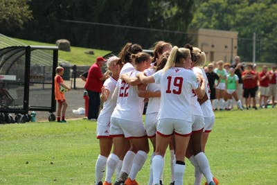 The IU women's soccer team celebrates its first goal of the season, scored by senior forward Annelie Leitner on Sunday, Aug. 19 at Bill Armstrong Stadium. The team is 2-0 in Big Ten Conference play this season.