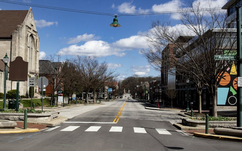 <p>Kirkwood Avenue appears empty March 29 near the Graduate Hotel. Gov. Eric Holcomb issued a stay-at-home order March 23 asking Hoosiers to stay inside. </p>