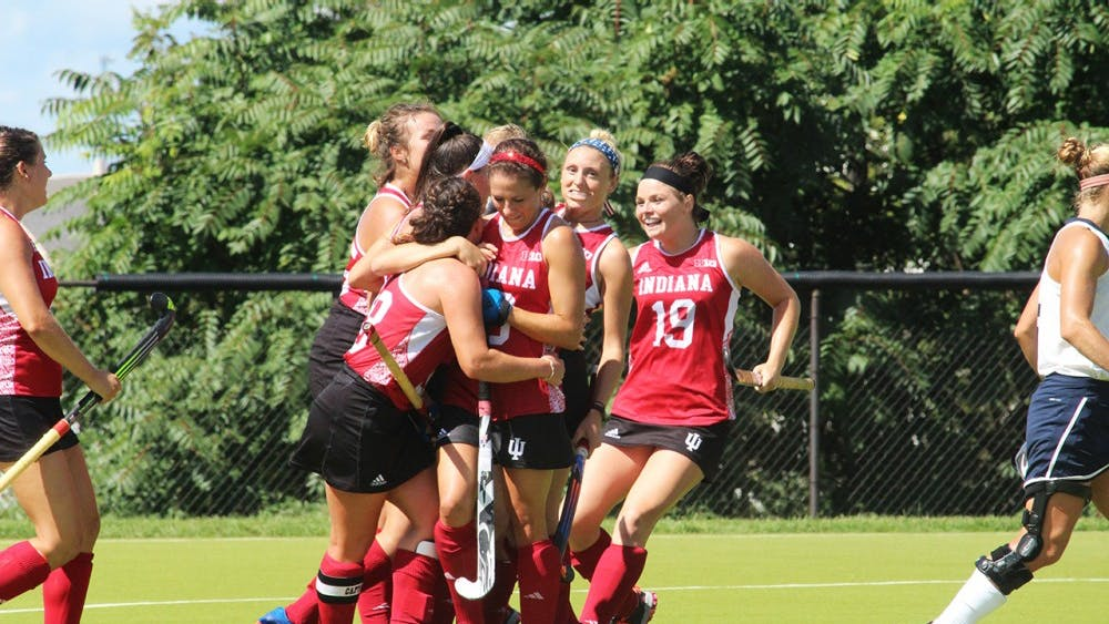 The IU Women's Field hockey team celebrates their first goal in their game Sunday against the University of New Hampshire at the IU Field Hockey Complex.