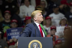 President Trump pauses while the audience cheers at North Side Middle School on Thursday, May 10, in Elkhart, Indiana. Trump talked about border security, the economy and the upcoming elections in November.