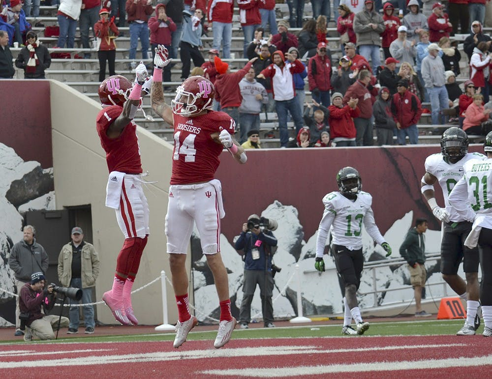Senior wide receivers Shane Wynn and Nick Stoner celebrate after Wynn scored a touchdown in IU's game against North Texas on Saturday at Memorial Stadium.