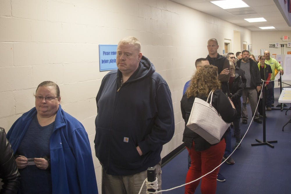 <p>People line up to receive their paper ballots Nov. 6 in Emmanuel Baptist Church. People voted for local and state officials during the midterms.</p>