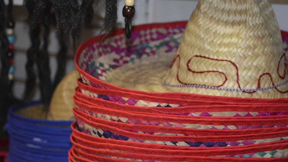 Sombreros sit on shelves along with other hats for Halloween at Campus Costume.
