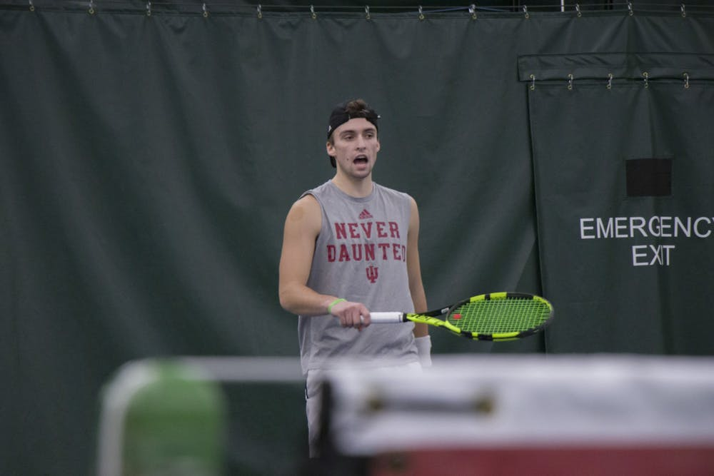 <p>Senior William Piekarsky returns the ball during a doubles match against the University of Memphis on Jan. 17 in the IU Tennis Center. Piekarsky is a Bloomington native majoring in professional sales/marketing and entrepreneurship. </p>