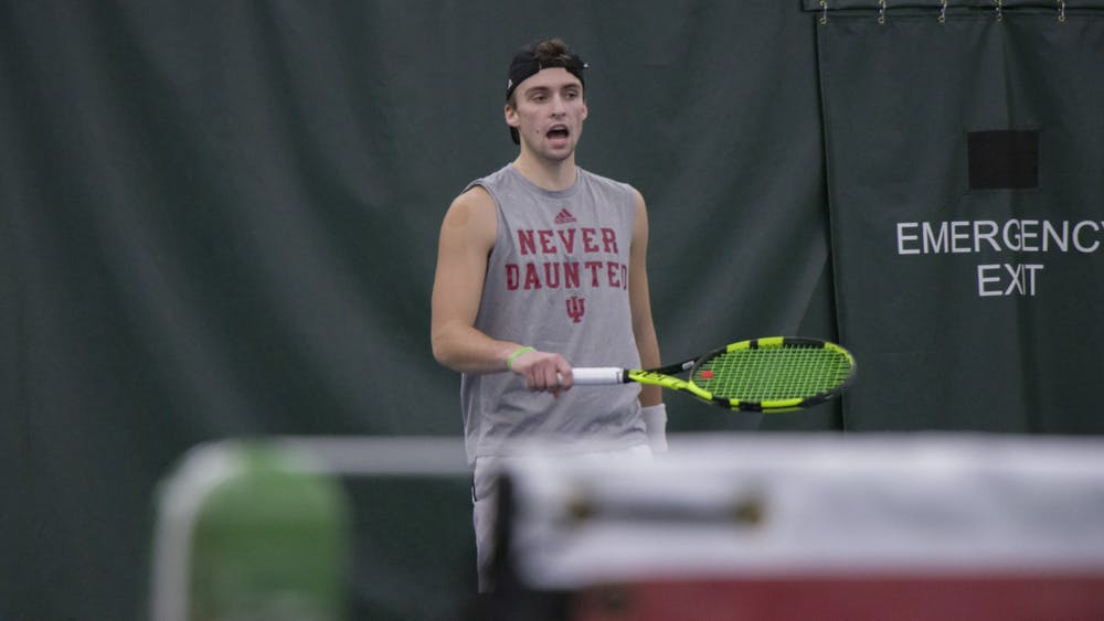 Senior William Piekarsky returns the ball during a doubles match against the University of Memphis on Jan. 17 in the IU Tennis Center. Piekarsky is a Bloomington native majoring in professional sales/marketing and entrepreneurship.