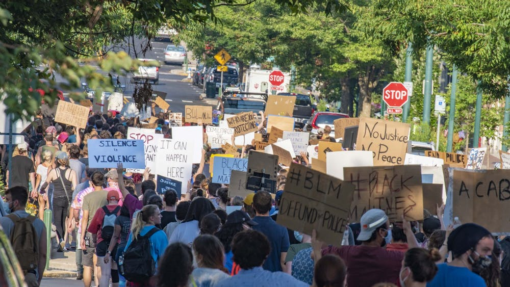 Protesters march in support of Black Lives Matter on July 7, 2020, up Kirkwood Avenue toward the Sample Gates.