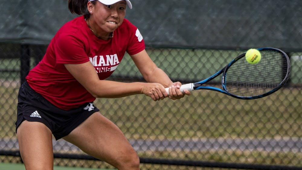 "Freshman Xiaowei ""Rose"" Hu goes to hit the ball Sept. 29 at the IU Hoosier Classic. Hu, who is from Beijing, China, is one of three freshmen on the team from a foreign country."