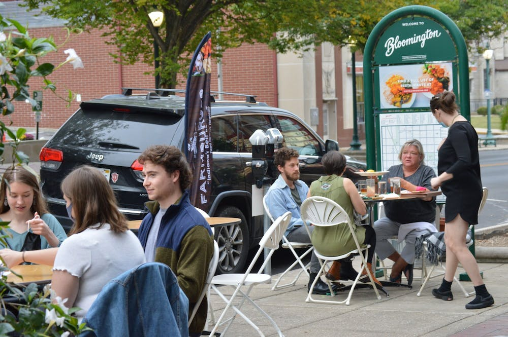 <p>Customers eat outside of FARM Bloomington in September 2020 on Kirkwood Avenue. Monroe County announced Tuesday that gatherings can be up to 50 people, but Bloomington gatherings must remain at 15 people. </p>