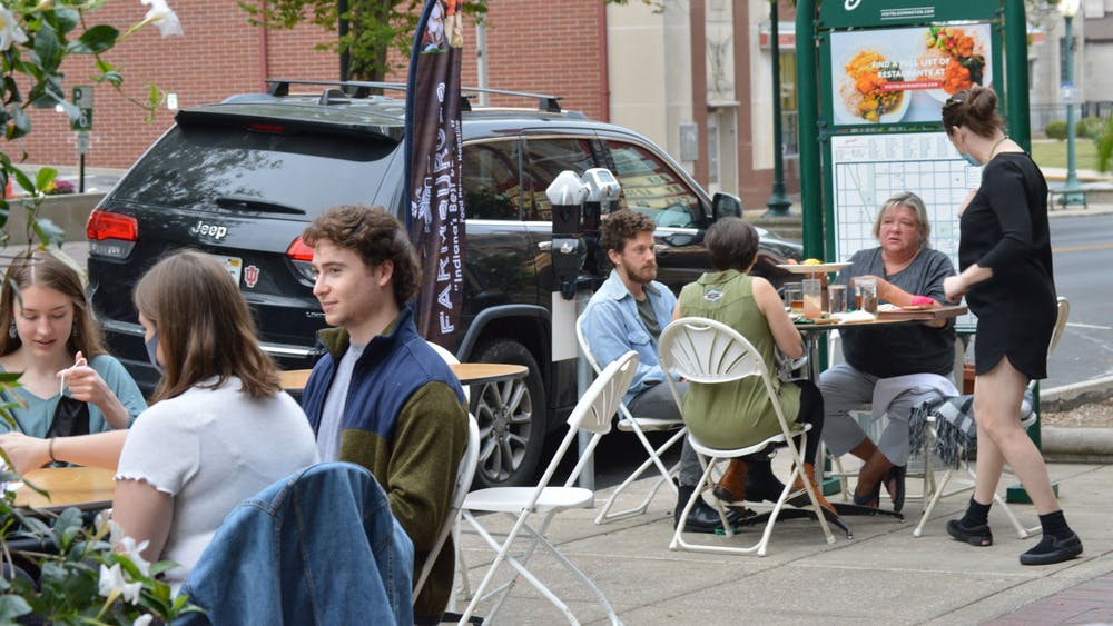 Customers eat outside of FARM Bloomington in September 2020 on Kirkwood Avenue. Monroe County announced Tuesday that gatherings can be up to 50 people, but Bloomington gatherings must remain at 15 people.