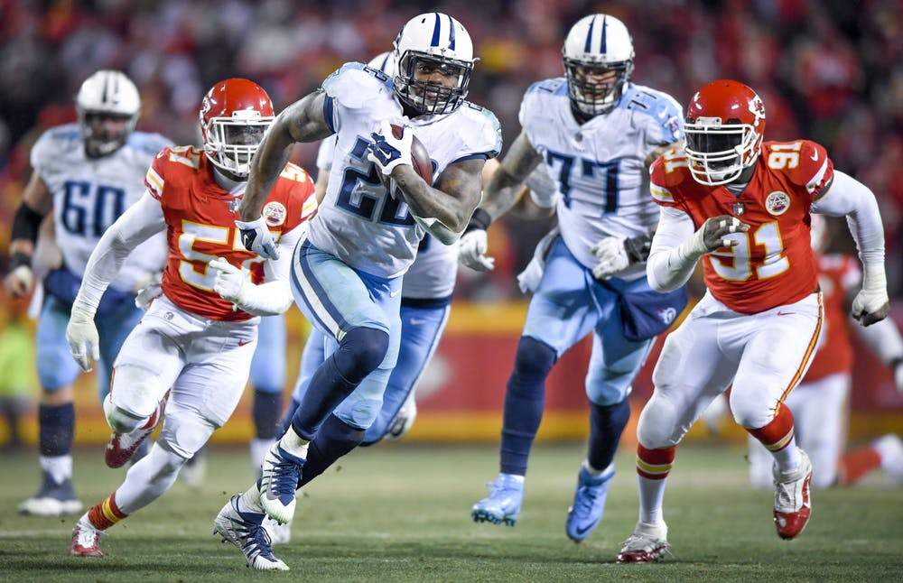 <p>Tennessee Titans running back Derrick Henry runs 35 yards for a touchdown in the fourth quarter as Kansas City Chiefs linebackers Kevin Pierre-Louis and Tamba Hali chase after him Jan. 6, 2018, during the AFC Wild Card playoff game at Arrowhead Stadium in Kansas City, Missouri. </p>