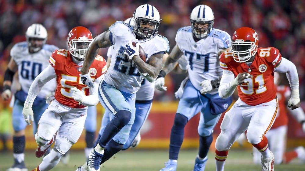 Tennessee Titans running back Derrick Henry runs 35 yards for a touchdown in the fourth quarter as Kansas City Chiefs linebackers Kevin Pierre-Louis and Tamba Hali chase after him Jan. 6, 2018, during the AFC Wild Card playoff game at Arrowhead Stadium in Kansas City, Missouri.