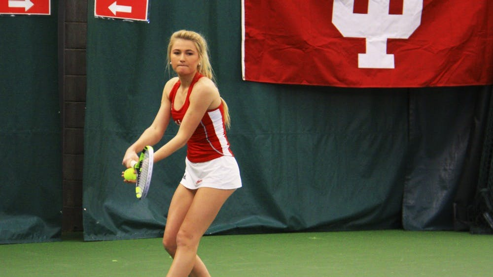 Sophomore Madison Appel serves the ball during the women's tennis doubles against West Virginia. The match took place Saturday morning in the IU Tennis Center.