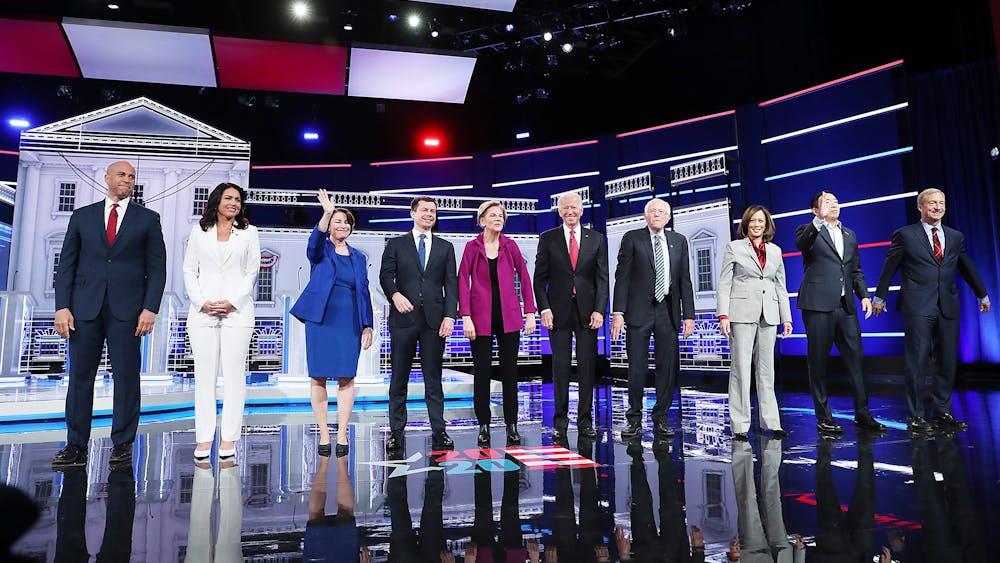 Democratic presidential candidates arrive on stage before the start of the Democratic presidential debate Wednesday at Tyler Perry Studios in Atlanta.