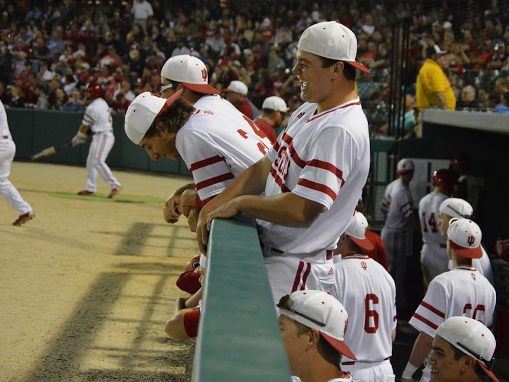 Hoosiers get rowdy in the dugout after gaining a lead over Ball State Tuesday night at Victory Field in Ind. IU beat Ball State 4-3.