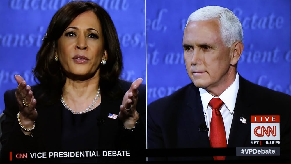 The vice presidential campaign debate between Democratic vice presidential nominee Sen. Kamala Harris and Vice President Mike Pence is seen Wednesday on a TV screen. The debate took place in Salt Lake City, Utah.