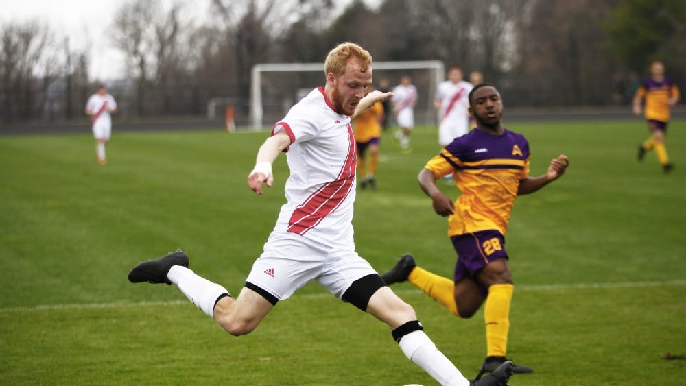 """Senior Simon Waever passes the ball for an attempted assist April 7 at Bill Armstrong Stadium. """"I heard some of my friends played college soccer and I wanted to look into it,"""" he said when discussing the idea of playing in college. """"But very few players in Europe grow up wanting to play soccer in the U.S."""""""