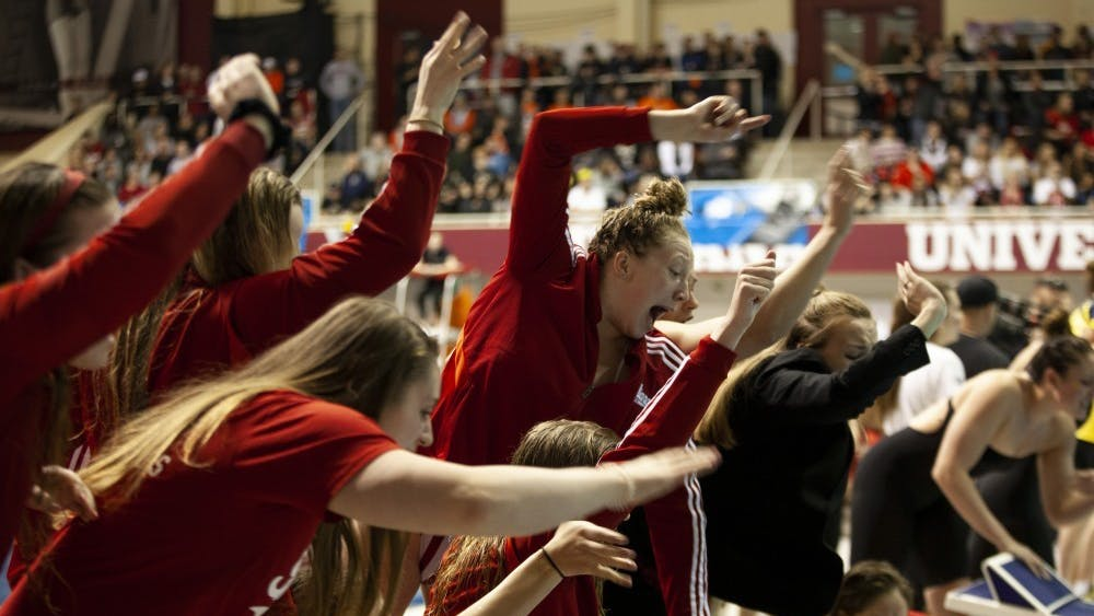 The IU women's swimming team cheers on then-junior, now-senior Shelby Koontz on Feb. 23 in the Counsilman Billingsley Aquatic Center. IU will compete against Purdue Jan. 25 at home.