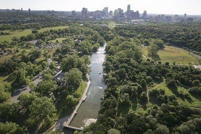 Aerial view of Barton Springs Pool looking north towards downtown Austin as seen on Sunday April 23, 2017.