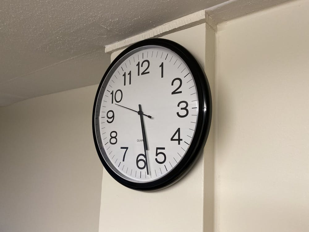 <p>A clock hangs on the wall Dec. 11 in Franklin Hall</p>