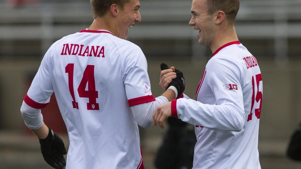 Senior defender Andrew Gutman, right, celebrates with sophomore midfielder Griffin Dorsey after Gutman's goal during IU's game against the University of Connecticut on Nov. 18 at Bill Armstrong Stadium. IU defeated UCONN 4-0 in the second round of the NCAA Tournament.