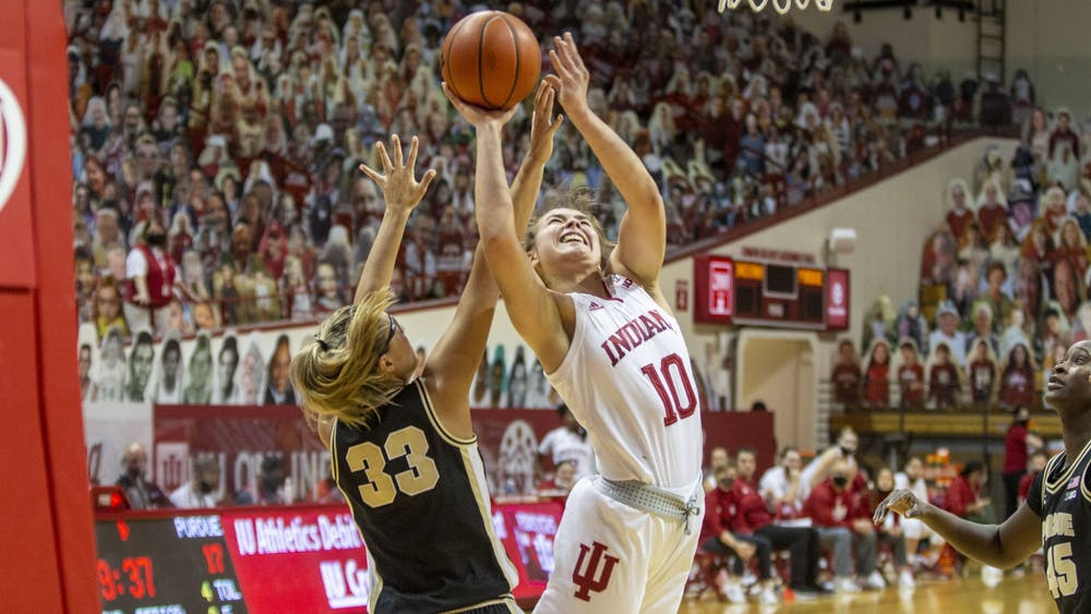 Junior forward Aleksa Gulbe attempts a layup March 6 at Simon Skjodt Assembly Hall. Gulbe had 11 points and 10 rebounds in IU's 73-70 win over NC State on Saturday in San Antonio.