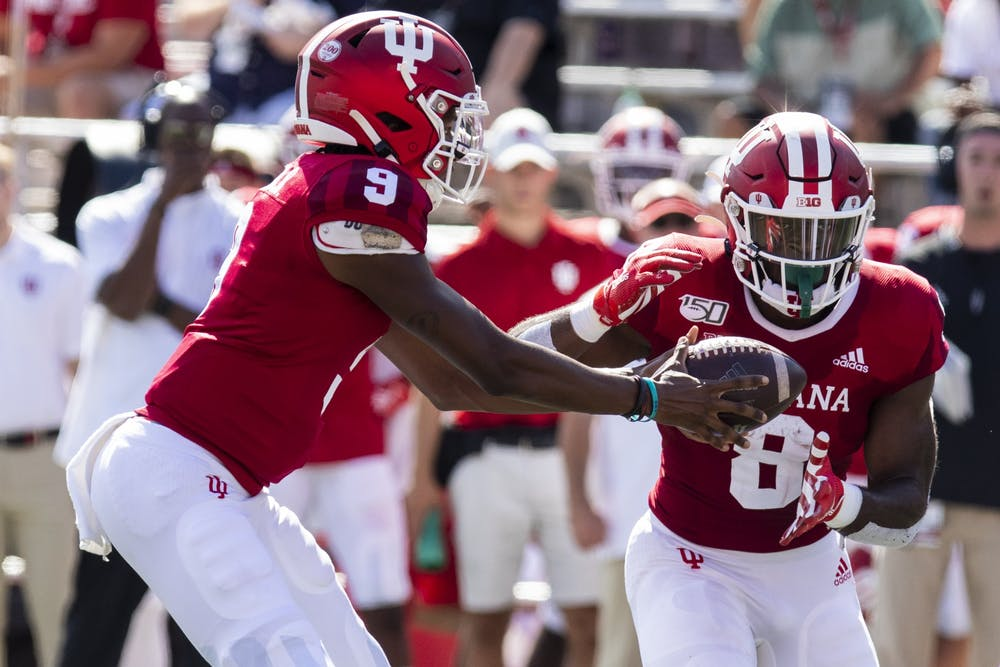 <p>Then-redshirt freshman quarterback Michael Penix Jr. hands the ball off to then-sophomore running back Stevie Scott III on Sept. 7, 2019, at Memorial Stadium. Scott is tied for eighth in program history with 20 rushing touchdowns.</p>