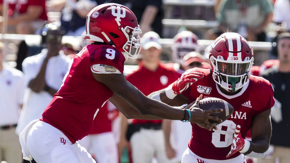 Then-redshirt freshman quarterback Michael Penix Jr. hands the ball off to then-sophomore running back Stevie Scott III on Sept. 7, 2019, at Memorial Stadium. Scott is tied for eighth in program history with 20 rushing touchdowns.
