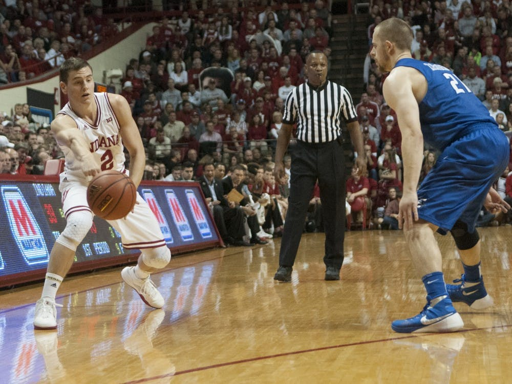 Redshirt senior Nick Zeisloft passes the ball during the game against Creighton on Thursday at Assembly Hall.