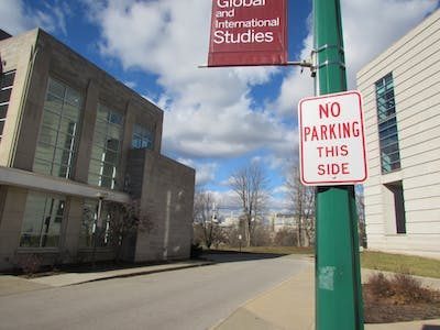 """No Parking This Side"" signs are posted throughout the streets on IU's campus."
