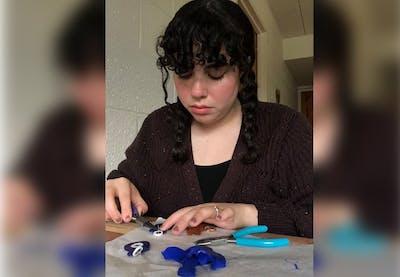 Junior Carolina Morales makes earrings. Morales owns a clay jewelry shop on Etsy called NinaMoraShop.