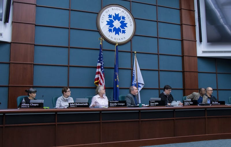 Bloomington city council members listen to public comment Oct. 23 at the Showers building. More than 50 people made public comments each night at Wednesday's and Thursday's special session meetings of the City of Bloomington City Council.