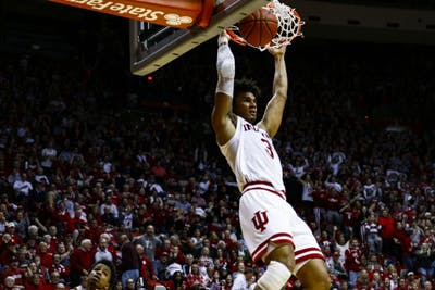 Sophomore forward Justin Smith dunks the ball against Nebraska on Jan. 14 at Simon Skjodt Assembly Hall. Smith scored 5 out of 51 points, and IU lost 51-66.